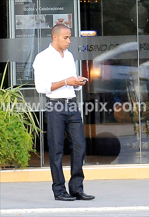 **ALL PICTURES FROM SOLARPIX.COM**.SYNDICATION RIGHTS FOR UK, CANADA, USA, SOUTH AFRICA, SOUTH AMERICA, DUBAI, AUSTRALIA, NEW ZEALAND, GREECE, ASIA.Formula One driver Lewis Hamilton and girlfriend Nicole Scherzinger from the Pussycat Dolls in Ibiza. Lewis is seen leaving a Casino with a friend whilst Nicole worked on her tan on a boat with some of her bandmates...This pic: Lewis Hamilton..JOB REF: 7056 SPA     DATE: 19_08_2008.**MUST CREDIT SOLARPIX.COM OR DOUBLE FEE WILL BE CHARGED* *UNDER NO CIRCUMSTANCES IS THIS IMAGE TO BE REPRODUCED FOR ANY ONLINE EDITION WITHOUT PRIOR PERMISSION*