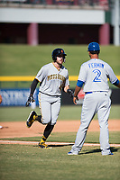 Surprise Saguaros first baseman Will Craig (45), of the Pittsburgh Pirates organization, is congratulated by Andy Fermin (2) as he rounds the bases after hitting a home run during an Arizona Fall League game against the Mesa Solar Sox at Sloan Park on November 1, 2018 in Mesa, Arizona. Surprise defeated Mesa 5-4 . (Zachary Lucy/Four Seam Images)