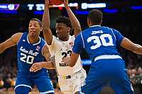 NEW YORK, NY - Thursday March 9, 2017: Jajuan Johnson (#23) of Marquette drives on Seton Hall as the two schools square off in the Quarterfinals of the Big East Tournament at Madison Square Garden.