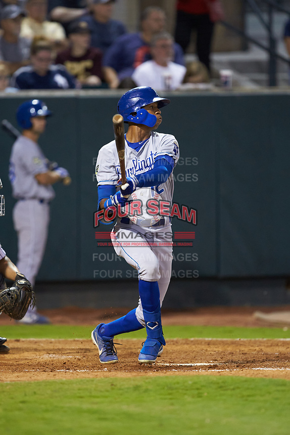 Burle Dixon (12) of the Burlington Royals follows through on his swing against the Pulaski Yankees at Calfee Park on September 1, 2019 in Pulaski, Virginia. The Royals defeated the Yankees 5-4 in 17 innings. (Brian Westerholt/Four Seam Images)