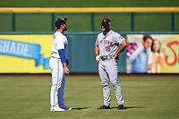 Mesa Solar Sox Ryan McBroom (9), of the Toronto Blue Jays organization, talks with Scottsdale Scorpions Tim Tebow (15), of the New York Mets organization, before a game on October 18, 2016 at Sloan Park in Mesa, Arizona.  Mesa defeated Scottsdale 6-3.  (Mike Janes/Four Seam Images)