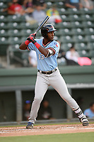 Third baseman Sherten Apostel (13) of the Hickory Crawdads bats in a game against the Greenville Drive on Wednesday, May 15, 2019, at Fluor Field at the West End in Greenville, South Carolina. Greenville won, 6-5. (Tom Priddy/Four Seam Images)