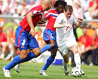 Jacek Krzynowek (8) of Poland goes through the Costa Rican defense. Poland defeated Costa Rica 2-1 in their FIFA World Cup Group A match at FIFA World Cup Stadium, Hanover, Germany, June 20, 2006.