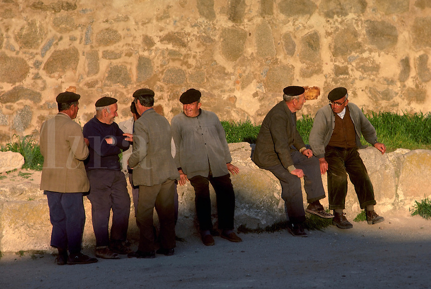 A neighborly group of men gather together for an afternoon break. Villagers. Spain.