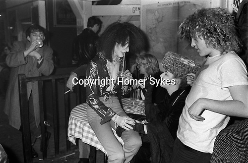 Blitz Kids New Romantics at The Blitz Club Covent Garden, London, England 1980. <br /> <br /> Jeremy Healy and Kim Bowen ( wearing a velvet hat by Stephen Jones ) with (soon-to-be deejay) Jeffrey Hinton.   <br /> <br /> My ref 25a/3991/1980