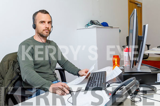 Derek Pyne manning the phone at the Kerry County Councils COVID-19 Kerry Community Response call centre in Killorglin on Tuesday.