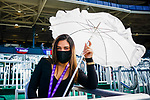 November 7, 2020 : An attendee uses an umbrella to find shelter from the sun on Breeders' Cup Championship Saturday at Keeneland Race Course in Lexington, Kentucky on November 7, 2020. Scott Serio/Eclipse Sportswire/Breeders' Cup/CSM