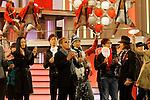 """Tokyo, Dec. 30, 2009 - Various famous Japanese artists, including Yukie NAKAMA, Saburo KITAJIMA and SMAP boy band, are photographed during the second day of rehearsals for 'Kohaku Uta Gassen,' or also more commonly known as 'Kohaku.' Produced by the Japanese public broadcaster, NHK, this annual music show airs on New Year's Eve and ends shortly before midnight, where everyone on air pauses to say """"Happy New Year."""" The 'Red and White Song Battle' separates the most popular music artists during each given year into teams of red and white: the red team consists of all female artists and the white team is all male artists. For an artist to perform on Kohaku, it is a great honor as only the most successful enka singers and J-Pop artist are strictly invited to perform by invitation only. Today, for a J-Pop artist or enka singer to perform on Kohaku, is most notably recognized to be a big highlight in a singer's career due to the show's large reach of audience during New Year's Eve."""