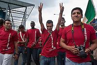 """Sesto San Giovanni (Milano), iniziativa di Radiopopolare per celebrare i 150 anni dell'unità d'Italia: 1000 cittadini italiani di origine straniera indossano una maglietta rossa e sfilando in corteo impersonano i """"nuovi garibaldini"""" --- Sesto San Giovanni (Milan), independent Radio station Radiopopolare initiative to celebrate the 150th anniversary of the unification of Italy: 1000 Italian citizens of foreign origin wear a red shirt and march in procession embodying the """"new follower of Garibaldi"""""""