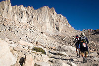 TWO DAY HIKERS ARE MAKING THEIR WAY UP TO MT. WHITNEY, THE HIGHEST PEAK IN THE CONTINENTAL UNITED STATES AT 14,505 FEET