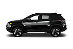 Car driver side profile view of a 2017 Jeep New Compass Trailhawk 5 Door SUV