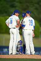 Hartford Yard Goats pitching coach Dave Burba (36) talks with relief pitcher Matt Pierpont (39) during the first game of a doubleheader against the Trenton Thunder on June 1, 2016 at Sen. Thomas J. Dodd Memorial Stadium in Norwich, Connecticut.  Trenton defeated Hartford 4-2.  (Mike Janes/Four Seam Images)