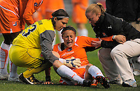 Sky Blue FC player Julianne Sitch is help by teammate Jenni Branam and a trainer after being injured during play. Sky Blue FC tied Chicago Red Stars 0-0 on April 19, 2009.