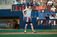 """Kannapolis Cannon Ballers Ticket Sales Account Executive Walker Brooke dances as part of the """"Ballerinas"""" between innings of the game against the Charleston RiverDogs at Atrium Health Ballpark on July 4, 2021 in Kannapolis, North Carolina. (Brian Westerholt/Four Seam Images)"""