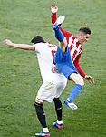 Atletico de Madrid's Fernando Torres (r) and Sevilla FC's Vicente Iborra during La Liga match. March 19,2017. (ALTERPHOTOS/Acero)