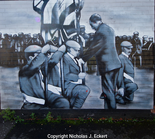 """This mural shows Sir Edward Carson in 1912 """"consecrating"""" the colors of the Ulster Volunteer Force, an exclusively Protestant militia that was formed to oppose Home Rule...with the use of force if necessary --with the weapons provided by the Kaiser's Germany, which is rather ironic to say the least (taking arms from Britain's enemy to remain """"British"""")."""