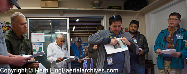 Cerified Flight Instructor Joshua Hochberg delivers a pilot briefing to pilots participating in a Young Eagles Rally at Lampson Field (102), Lakeport, California