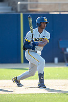 Michigan Wolverines outfielder Clark Elliott (15) follows through on his swing during the NCAA baseball tournament against the Connecticut Huskies on June 4, 2021 at Frank Eck Stadium in Notre Dame, Indiana. The Huskies defeated the Wolverines 6-1. (Andrew Woolley/Four Seam Images)