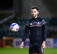Lincoln City's Adam Jackson during the pre-match warm-up<br /> <br /> Photographer Andrew Vaughan/CameraSport<br /> <br /> EFL Papa John's Trophy - Northern Section - Group E - Lincoln City v Manchester City U21 - Tuesday 17th November 2020 - LNER Stadium - Lincoln<br />  <br /> World Copyright © 2020 CameraSport. All rights reserved. 43 Linden Ave. Countesthorpe. Leicester. England. LE8 5PG - Tel: +44 (0) 116 277 4147 - admin@camerasport.com - www.camerasport.com