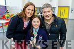 Rachael Lennon who place second with her school Ardfert NS with her parents Brian and Geraldine at the Cara Credit Union School Quiz in the I T Tralee on Sunday.