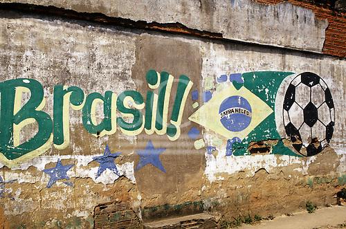 "Brazil. Brazilian flag , football and ""Brasil!"" painted on a wall."