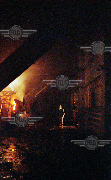 Worker on a night shift tends to the large furnaces which burn coal to provide hot water for the state run mining compound.  Industrial boilers and furnaces consume almost half of the coal which China produces and of all the provinces, Shanxi is the largest producer of coal in China.