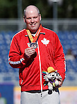 Kyle Pettey, Toronto 2015 - Para Athletics // Para-athlétisme.<br /> Kyle Pettey receives his Bronze medal for the Men' Shot Put F32/33/34 // Kyle Pettey reçoit sa médaille de bronze au lancer du poids masculin F32 / 33/34. 12/08/2015.