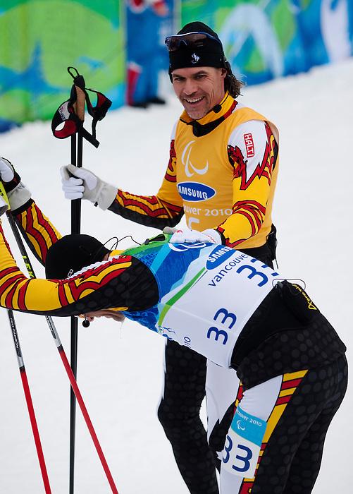 Alexei Novikov and Jamie Stirling, Vancouver 2010 - Para Nordic Skiing // Ski paranordique.<br /> Alexei Novikov and guide Jamie Stirling compete in Para Nordic Skiing // Alexei Novikov et son guide Jamie Stirling concourent en ski paranordique. 15/03/2010.