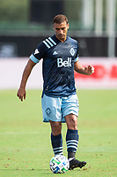 LAKE BUENA VISTA, FL - JULY 23: Ali Adnan #53 of Vancouver Whitecaps FC kicks the ball during a game between Chicago Fire and Vancouver Whitecaps at Wide World of Sports on July 23, 2020 in Lake Buena Vista, Florida.