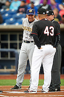 Burlington Bees manager Adam Melhuse (6) during during the lineup exchange with Omar Lopez (43) and umpire Austin Jones before a game against the Quad Cities River Bandits on May 9, 2016 at Modern Woodmen Park in Davenport, Iowa.  Quad Cities defeated Burlington 12-4.  (Mike Janes/Four Seam Images)