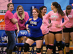 Marymount's Cassidie Watson, center, gets ready for a college volleyball match against Shenandoah at Marymount University in Arlington, Vir., on Tuesday, Oct. 8, 2013.<br /> Photo by Cathleen Allison