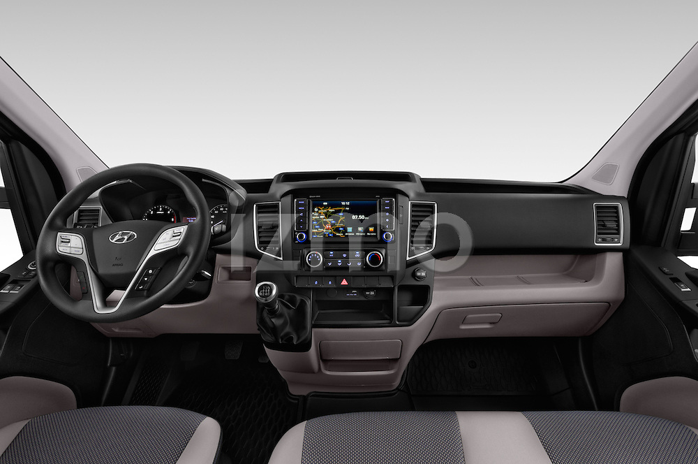 Stock photo of straight dashboard view of 2015 Hyundai H350 Travel Plus Pack 4 Door Cargo Van 2WD Dashboard