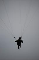 A paraglider soars above Torrey Pines Glider Port in San Diego California, October 21 2007.