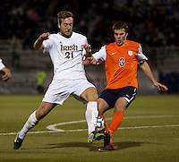 Vince Cicciarelli (21) of Notre Dame is tackled by Matt Brown (3) of Virginia during the ACC tournament semifinals at the Maryland SoccerPlex in Boyds, MD.  Virginia advanced to the finals after tying Notre Dame, 3-3, in overtime and then defeating them on penalty kicks.
