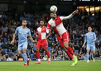 21st September 2021; Etihad Stadium,Manchester, England; EFL Cup Football Manchester City versus Wycombe Wanderers; Ryan Tafazolli of Wycombe Wanderers heads a clearance