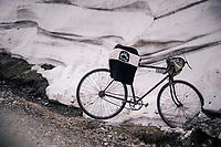 ancient model awaiting the peloton up the gravel roads of the Colle delle Finestre <br /> <br /> stage 19: Venaria Reale - Bardonecchia (184km)<br /> 101th Giro d'Italia 2018