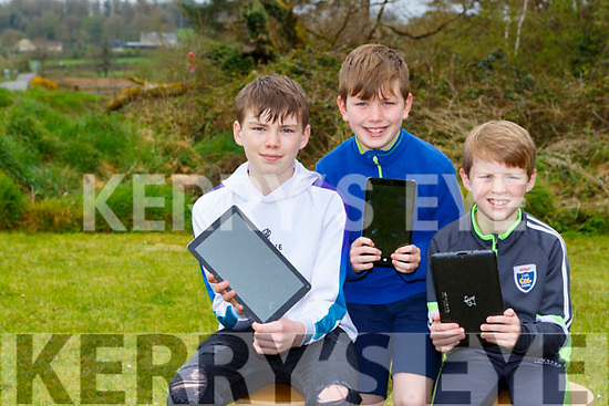 Alex Neil and Karl Thompson Rathmore who are cleaning old tablets and donating them