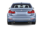 Straight rear view of 2014 BMW SERIES 3 Sport 4 Door Sedan 2WD Rear View  stock images
