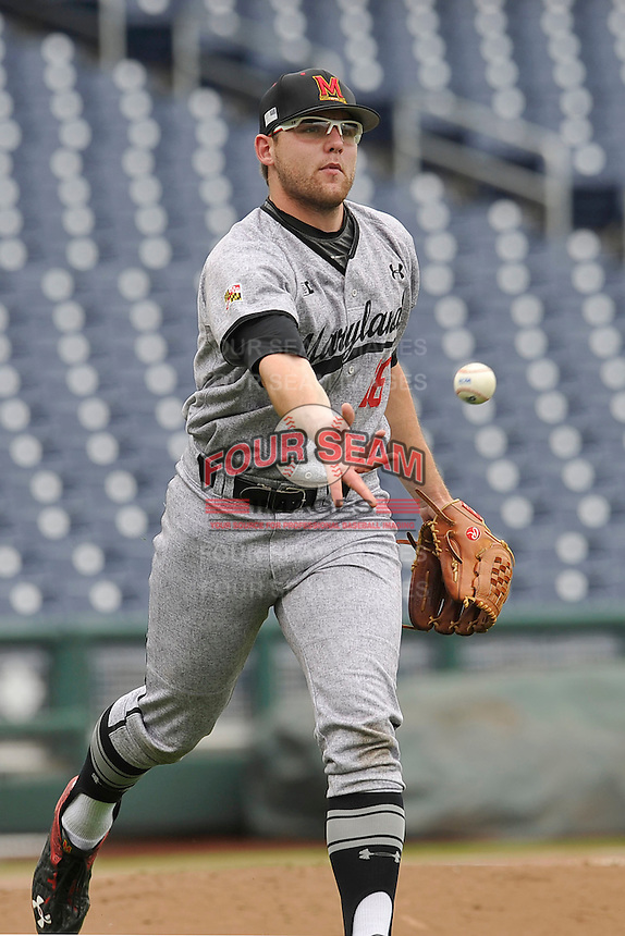 Maryland Terrapins Mike Shawaryn (18) tosses ball to first baseman during the Big Ten Tournament game against the Indiana Hoosiers at TD Ameritrade Park on May 25, 2016 in Omaha, Nebraska.  Maryland  won 5-3.  (Dennis Hubbard/Four Seam Images)