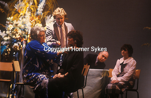 Doris Collins (1918-2003) was a British spiritualist and psychic medium. Public performance at Wimbledon Theatre SW London 1980s. UK