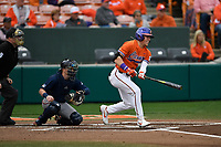 Right fielder Michael Green (11) of the Clemson Tigers bats in a game against the South Alabama Jaguars on Opening Day, Friday, February 15, 2019, at Doug Kingsmore Stadium in Clemson, South Carolina. Clemson won, 6-2. (Tom Priddy/Four Seam Images)