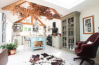 BNPS.co.uk (01202 558833)<br /> Pic: Cheffins/BNPS<br /> <br /> Pictured: The kitchen has been extended and modernised<br /> <br /> Crime history fans can live in the home of notorious highwayman Dick Turpin for £1,950 a month.<br /> <br /> The infamous criminal ran a butcher's shop from this pretty thatched cottage before he joined a deer thief gang in the 1730s.<br /> <br /> Turpin was born opposite this house at the Bluebell Inn and staged cockfights in a grass area opposite the house which is still known as Turpin's ring.<br /> <br /> Robert Palmer bought the Grade II Listed Dick Turpin's Cottage in Hempstead, Essex, in 2012 and spent eight years gutting and refurbishing the house to make it more suitable for modern living.