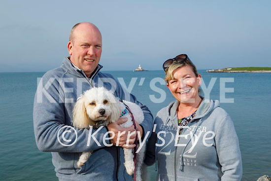 Enjoying a stroll in Fenit on Good Friday, l to r: Emer O'Leary and Jerry Howard with Millie the dog.