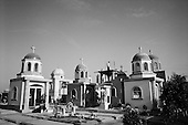 Culiacan, Mexico<br /> June 12, 2007<br /> <br /> The monuments to the dead in Culiacan. Many of the elaborate tombs are those of drug traffickers who were executed here. Certain tombs contain images of drug traffickers banishing their automatic weapons.