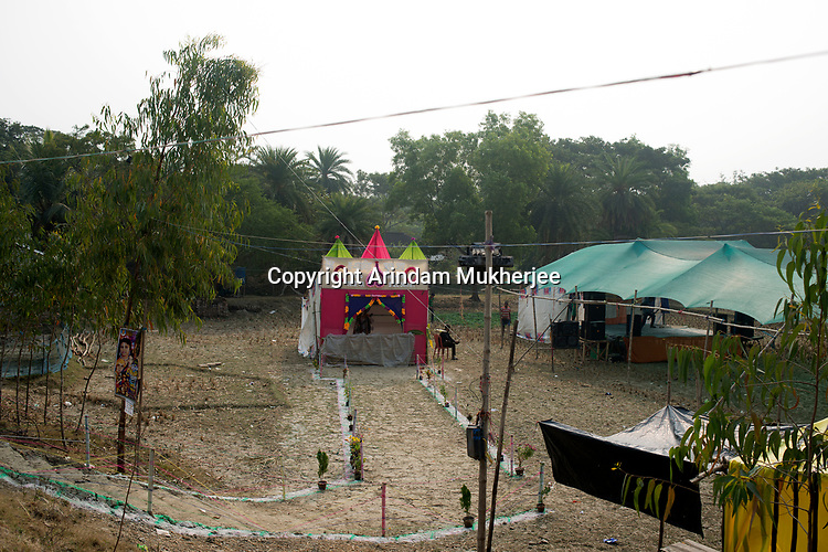 A tent has been erected for cultural program on the occassion of Sarwasati (goddess of education) Puja (worship). Popular form of entertainment have not reached this delta land. Suderbans, West Bengal, India, Arindam Mukherjee.