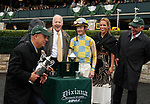 """LEXINGTON, KY - October 8, 2017. Trainer Mark Casse playfully pretends to take off with the winning trophy in the winners circle presentation, while waiting for an objection that resulted in #1 Tigers Rule being moved from 2nd to 3rd place.   <br /> #12 Flameaway and Julien Leparoux after winning the 27th running of the Dixiana Bourbon Grade 3 $250,000 """"Win and You're In Breeders' Cup Juvenile Turf Division"""" for owner John Oxley and trainer Mark Casse at Keeneland Race Course.  Lexington, Kentucky. (Photo by Candice Chavez/Eclipse Sportswire/Getty Images)"""