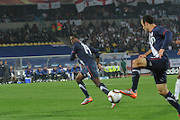 U.S. substitute forward Edson Buddle runs off Landon Donovan's possession during the team's match with England in their debut match of the 2010 FIFA World Cup. The U.S. and England played to a 1-1 draw in the opening match of Group C play at Rustenburg's Royal Bafokeng Stadium, Saturday, June 12th.