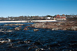 Milford Dam, Milford, Maine during high water event showing power station on right side of Penobscot River