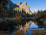 Yosemite National Park, CA: The Three Brothers reflected in the Merced River in fall