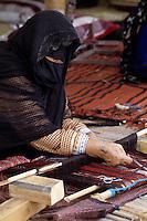 Masirah, Oman, Arabian Peninsula, Middle East - Woman from Masirah Weaving.